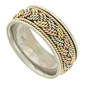Curling ropes of 14K yellow, red and white gold twist into a tri-colored braid on the face of this mens estate wedding band