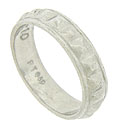 Faceted surfaces on the face of this estate wedding band gives interest to the ring
