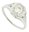 This spectacular antique engagement ring features a European cut, .61 carat, I color, Si1 clarity diamond