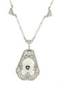 This elegant 14K white gold necklace features a crystal carved with a radiant design and adorned with a single fine faceted diamond