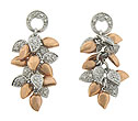 Extraordinary tumbles of 14K rose and white gold leaves dangle from a single ring post on these antique style earrings