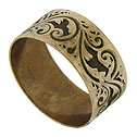 This Victorian wedding band is crafted of 8ct rose gold and impressed with a whirling pattern of vines and abstract leaves