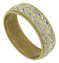 Abstract floral engraving slices into the surface of this 14K yellow gold wedding ring to reveal a sparkling white gold interior