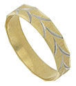 Simple jewel cut engraving reveals a dazzling white gold center on the surface of this 14K yellow gold estate wedding band