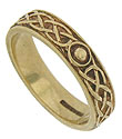 A Celtic inspired braid and faux engraved stones adorn the surface of this antique 14K yellow gold wedding band