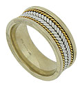 This handsome mens estate wedding band is crafted of 18K yellow gold and platinum