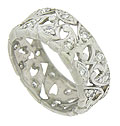 This spectacular antique platinum wedding band features bold, abstract floral cutwork set with dazzling round cut diamonds