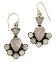 Cabochon rose quartz are bezel set in these fabulous sterling silver dangle earrings