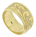 A rich, bold floral engraving adorns the surface of this 14K yellow gold wedding band