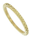 A deeply engraved zig zag pattern dances across the surface of this elegant 14k yellow gold wedding band