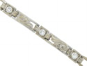 This elegant vintage bracelet is fashioned of 14K white gold and set with round cut diamonds
