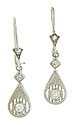 Teardrop figures decorated with filigree and floral engraving dangle from wires on these antique style earrings