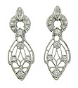 These abstract organic earrings are fashioned of platinum and set with dazzling round cut diamonds