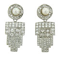 These handsome Art Deco earrings feature a spectacular diamond frosted dangle and abstract organic post set with a single cultured pearl