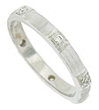 This estate wedding band is fashioned of 18K white gold and set with six, round cut brilliant diamonds