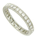 A string of dazzling diamonds are set into the face of this spectacular 14K white gold diamond wedding band