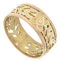 Bold floral cutwork of yellow and rose gold is pressed between polished rose gold bands on this magnificent 14K antique wedding ring