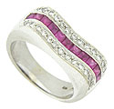 A bold scooped surface set with a string of square cut rubies framed with round cut diamonds adorns the face of this incredible 14K white gold wedding band