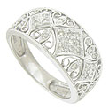 This elegant 14K white gold wedding band is adorned with curling filigree and diamond shaped cutwork