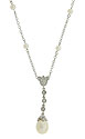 A sparkling diamond frosted dangle adorns the center of this romantic 14K white gold necklace