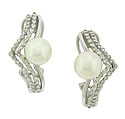 A luminous pearl presses into a pair of diamond frosted strands on the surface of these elegant estate earrings