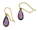 These elegant 14K yellow gold earrings are set with teardrop cut amethyst and dangle from wires