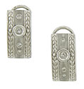 Elongated ribbons of 14K white gold form the surface of these handsome estate earrings