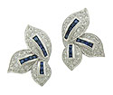 A trio of sparkling white gold leaves form these magnificent 14K white gold estate earrings