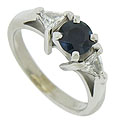 A deep blue .70 carat round cut sapphire is set into the center of this elegant estate engagement ring
