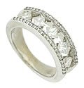 Five brilliant square cut diamonds, set on edge appear to pirouette in the center of this breathtaking 14K white gold wedding band