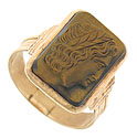 This elegant estate ring features a handsome slice of tigers eye carved with the profile of an ancient Greek citizen