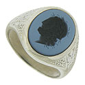 This wonderful antique ring features an oval stone deeply engraved with a Greek warrior