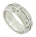 Deep cut channels and impressed rivets adorn the surface of this handsome 18K white gold Tiffany and Co