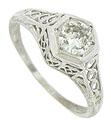 Organic cutwork and engraving decorate the sides and shoulders of this fantastic 14K white gold engagement ring