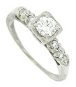 This elegant platinum vintage engagement ring features a .45 carat, G color, Vs1 clarity diamond