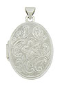 Intricate floral engraving and impressed milgrain swirl around the surface of this elegant 14K white gold estate locket