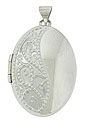 Trailing vines of engraving cover half of this romantic 14K white gold estate locket