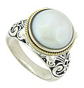 A luminous Mabe pearl is set into the face of this brightly polished sterling silver ring