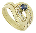 Wide ribbons of 14K yellow gold entwine with loops of channel set fine faceted diamonds on this spectacular estate ring