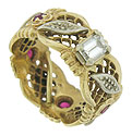 This romantic 14K yellow gold antique engagement ring features lattice filigree and engraved flowers