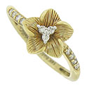 This elegant 14K yellow gold engagement ring is fashioned in the form of a delicate flower