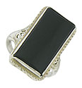 A smooth polished rectangular cut onyx adorns the face of this romantic 14K white gold estate ring