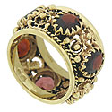 Oval cut garnets are set around the entire circumference of this 14K yellow gold vintage ring