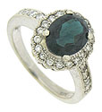 An elegant oval cut tourmaline is the star of this floral inspired estate ring