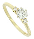 This romantic 14K yellow gold vintage engagement ring features a luminous .30 carat, H color, Si1 clarity diamond