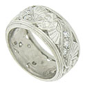 Spectacular floral engraving and cutwork leaves spin across the face of this antique platinum wedding band