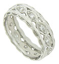 A ribbon of diamond set cutwork is framed by scalloped bands on this elegant antique wedding ring