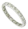 This antique platinum wedding band is set with a dazzling string of fine faceted diamonds
