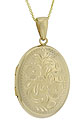 This elegant 14K yellow gold locket is oval in shape and adorned with intricately engraved flowers and leaves