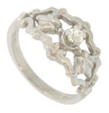 This antique style engagement ring is crafted of 14K white gold and set with a .18 carat, I color, Si1 clarity, round cut diamond
